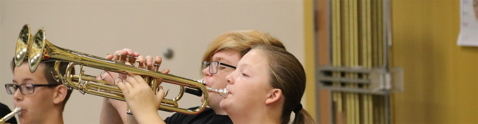 Students playing horns.